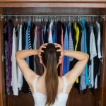 Colorful closet. Woman in white dress.